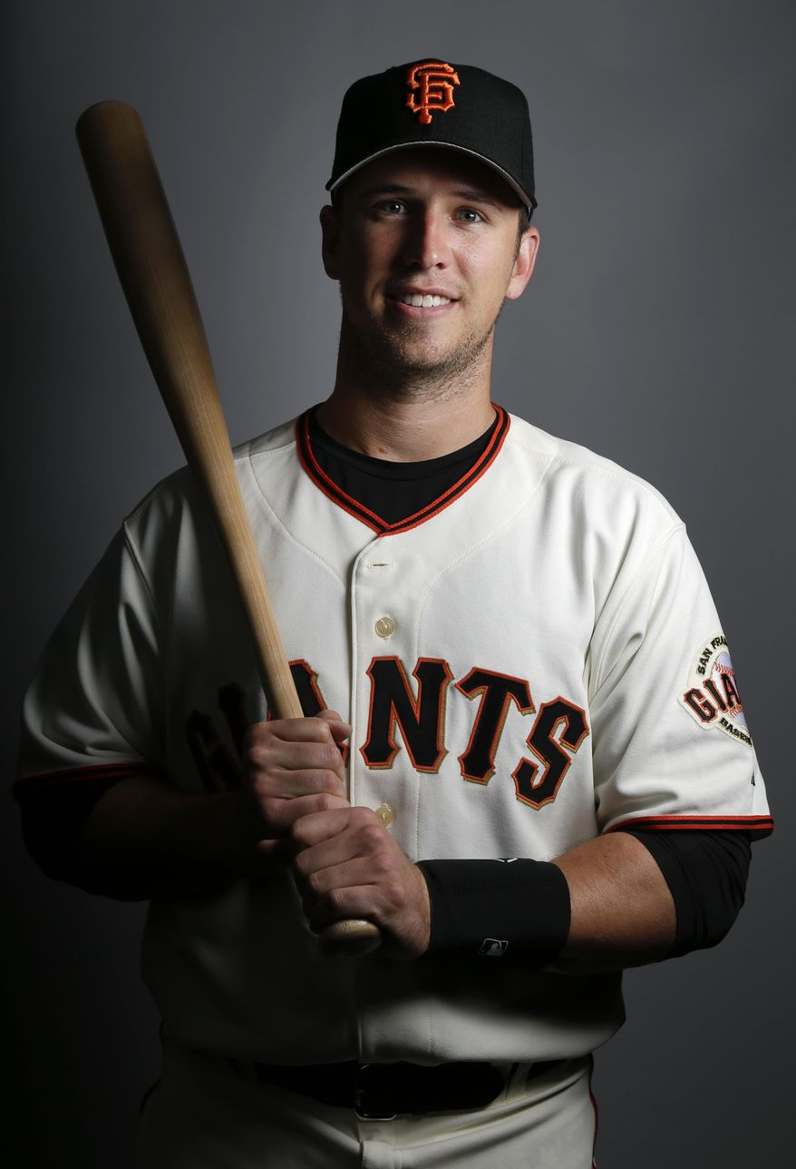San Francisco Giants catcher Buster Posey poses during the team photo day before a spring training baseball workout Sunday, Feb. 23, 2014, in Scottsdale, Ariz. (AP Photo/ Gregory Bull)