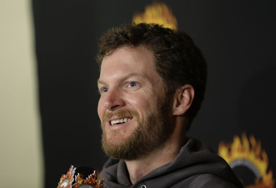 Daytona 500 winner Dale Earnhardt Jr. talks to the media during a victory tour stop, Tuesday, Feb. 25, 2014, in Austin, Texas. Earnhardt won his second Daytona 500 Sunday. (AP Photo/Eric Gay)
