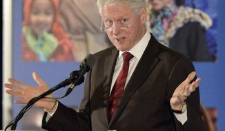 Former President Bill Clinton speaks to group of supporters during a fundraiser for Democratic Senate challenger Alison Lundergan Grimes, Tuesday, Feb. 25, 2014, in Louisville, Ky. (AP Photo/Timothy D. Easley)