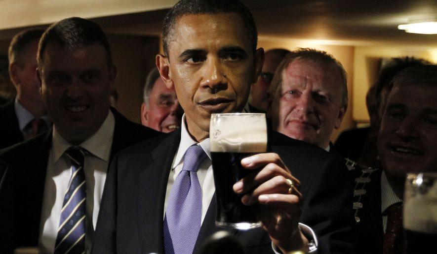 **FILE** U.S. President Barack Obama drinks a Guinness beer as he meets with local residents at Ollie Hayes pub in Moneygall, Ireland, the ancestral homeland of his great-great-great grandfather, Monday, May 23, 2011. (AP Photo/Charles Dharapak)