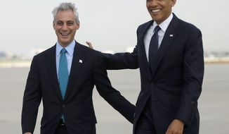 **FILE** President Obama walks with Chicago Mayor Rahm Emanuel on the tarmac upon his arrival at O'Hare International Airport in Chicago on May 29, 2013. (Associated Press)