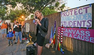 Daniella McDonald, an activist and supporter of the School Success and Opportunity Act (AB1266), tells attendees at a rally organized by San Diego LGBTQ rights organizations Canvass for a Cause, SAME Alliance, and Black and Pink that the petition drive to place a proposition on the ballot to repeal the law failed to garner enough signatures Monday, Feb. 24, 2014, in San Diego. (AP Photo/Lenny Ignelzi)