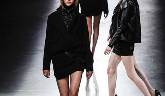A model wears a creation for Antony Vaccarello's ready to wear fall/winter 2014-2015 fashion collection presented in Paris, Tuesday, Feb. 25, 2014. (AP Photo/Zacharie Scheurer)