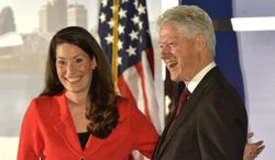Democratic Senate challenger Alison Lundergan Grimes left, speaks with former Presidet Bill Clinton as they are introduced at a fundraiser at the Galt House Hotel, Tuesday, Feb. 25, 2014, in Louisville, Ky. (AP Photo/Timothy D. Easley)