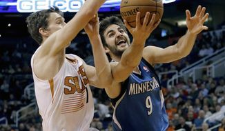 Minnesota Timberwolves Ricky Rubio (9) drives past Phoneix Suns guard Goran Dragic, of Slovenia, during the first half of an NBA basketball game, Tuesday, Feb. 25, 2014, in Phoenix. (AP Photo/Matt York)