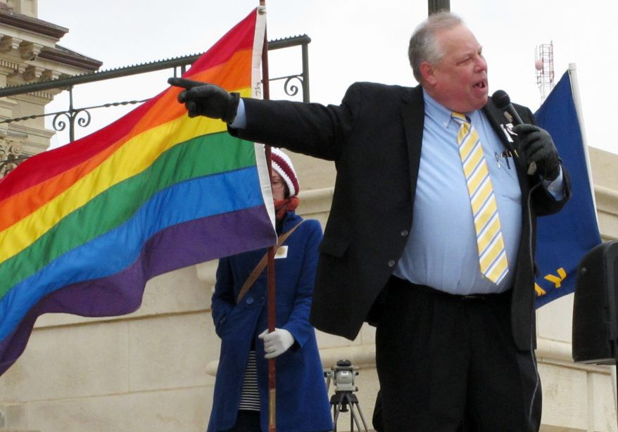 """Tom Witt, executive director of Equality Kansas, the state's leading gay-rights group, urges participants at a Statehouse rally to work to defeat conservative legislators, Tuesday, Feb. 25, 2014, in Topeka, Kan. Dozens rallied for gay rights as backers of """"religious freedom"""" legislation worked to counter perceptions that their measure would encourage widespread discrimination against gays and lesbians. (AP Photo/John Hanna)"""