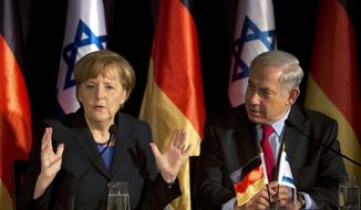 German Chancellor Angela Merkel, left, speaks during joint a press conference with Israeli Prime Minister Benjamin Netanyahu, in Jerusalem, Israel, Tuesday, Feb. 25, 2014. (AP Photo/Oded Balilty)