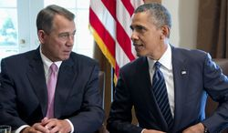 FILE - This Sept. 3, 2013 file photo shows President Barack Obama talking with House Speaker John Boehner of Ohio in the Cabinet Room of the White House in Washington. The president has reached out to Boehner for a rare one-on-one meeting between the political rivals. The Democratic president and Republican speaker plan to meet privately in the Oval Office midday Tuesday.   (AP Photo/Carolyn Kaster, File)