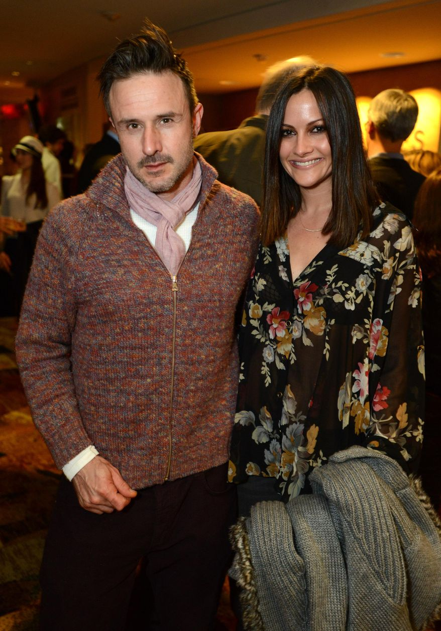 """FILE - This Feb. 6, 2013 file photo shows actor David Arquette, left, and Christina McLarty at the opening night of """"The Gift"""" at the Geffen Playhouse in Westwood, Calif. Arquette and McLarty are expecting a baby boy in May. (Photo by Jordan Strauss/Invision/AP, File)"""