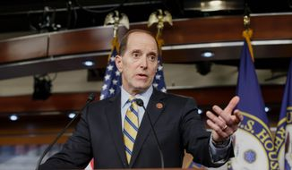 House Ways and Means Committee Chairman Rep. Dave Camp, Michigan Republican, drew fire from all sides on Wednesday on Capitol Hill after outling a major plan to rewrite the nation's tax code. (Associated Press)