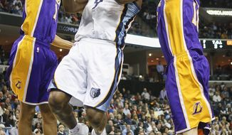 Memphis Grizzlies guard Tony Allen (9) goes to the basket between Los Angeles Lakers forward Wesley Johnson, left, and center Pau Gasol in the second half of an NBA basketball game, Wednesday, Feb. 26, 2014, in Memphis, Tenn. The Grizzlies won 108-103. (AP Photo/Lance Murphey)