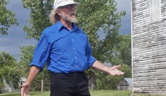 FILE - In this Aug. 26, 2013 file photo, white supremacist Craig Cobb stands in an empty lot he owns in Leith, N.D. Cobb, 62, who tried to turn the small North Dakota town into an all-white enclave said Wednesday, Feb. 26, 2014, he would like to leave the state if he can avoid prison time. Cobb says he fears violent repercussions. He is currently jailed for allegedly terrorizing residents of Leith with guns in mid-November. He has pleaded not guilty. (AP Photo/Kevin Cederstrom, File)