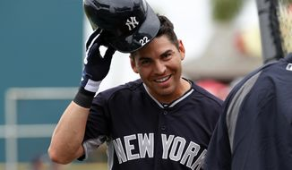 New York Yankees' Jacoby Ellsbury waits his turn in the batting cage at McKechnie Field before an exhibition spring training baseball game against the Pittsburgh Pirates in Bradenton, Fla.,  Wednesday, Feb. 26, 2014. (AP Photo/Gene J. Puskar)