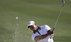 Golfer Tiger Woods hits out of a sand trap on the fourth hole during the Pro-Am round of the Honda Classic golf tournament, Wednesday, Feb. 26, 2014 in Palm Beach Gardens, Fla. (AP Photo/Wilfredo Lee)