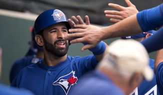 Toronto Blue Jays' Jose Bautista is congratulated by teammates after scoring in the third inning of a spring baseball exhibition game against the Philadelphia Phillies in Clearwater, Fla., on Wednesday Feb. 26, 2014. (AP Photo/The Canadian Press, Frank Gunn)