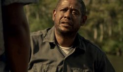 """This photo provided by Codeblack Films shows Forest Whitaker, right, in a scene from the film, """"Repentance."""" He plays the role of the bipolar Angel Sanchez, who seeks private treatment from a spiritual adviser before taking him hostage in the basement of the home where he and his young daughter reside.  Whitaker took on a new challenge to grow in the psychological thriller which releases Friday, Feb. 28, 2014.  (AP Photo/Codeblack Films, Patti Perret)"""