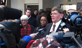 Trenton Acting Mayor George Muschal addresses reporters Wednesday, Feb. 26, 2014 in city hall in Trenton, N.J. after being sworn into office in private. Muschal took office Wednesday after a judge removed Tony Mack from office 19 days after he was convicted of corruption. (AP Photo/Geoff Mulvihill)
