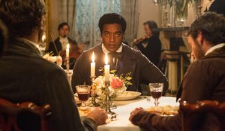"This film publicity image released by Fox Searchlight shows Chiwetel Ejiofor in a scene from ""12 Years A Slave."" This year's best picture race at the 86th Academy Awards on Sunday, March 2, 2014, has shaped up to be one of the most unpredictable in years. The favorites are ""12 Years a Slave,"" ""Gravity"" and ""American Hustle."" (AP Photo/Fox Searchlight Films, Jaap Buitendijk, file)"