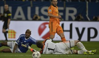 Real's Karim Benzema, top centre scores past Schalke goalkeeper Ralf Faehrmann during a Champions League round of sixteen, first leg soccer match between Schalke 04 and Real Madrid at the Veltins Arena in Gelsenkirchen, Germany, Wednesday Feb. 26, 2014. (AP Photo/Martin Meissner)