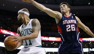 Atlanta Hawks guard Kyle Korver (26) defendsBoston Celtics guard Jerryd Bayless (11) during the first quarter of an NBA basketball game in Boston, Wednesday, Feb. 26, 2014. (AP Photo/Elise Amendola)