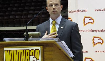 """FILE - In this April 5, 2012 file photo, Pat Kelsey speaks to fans as he is introduced as the new Winthrop men's basketball coach during a news conference at the Winthrop Coliseum in Rock Hill, S.C. A short time after her 7-year-old son, Chase, died in the Newtown, Conn., shootings at Sandy Hook Elementary, Becky Kowalski watched video of Winthrop basketball coach Pat Kelsey's heartfelt words about the tragedy. """"He gets it,"""" she said at the time. """"He understands."""" The Kowalski family will meet Kelsey this week when they attend Winthrop's home game with Presbyterian on Saturday, March 1, 2014. (AP Photo/Jeffrey Collins, File)"""
