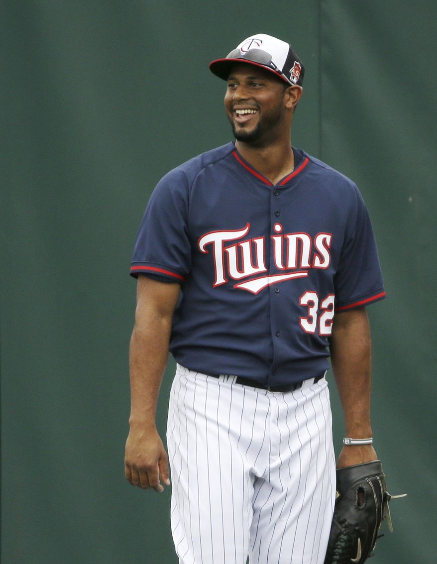 Minnesota Twins center fielder Aaron Hicks  smiles while working out on the field during spring training baseball practice Tuesday, Feb. 25, 2014, in Fort Myers, Fla. (AP Photo/Steven Senne)