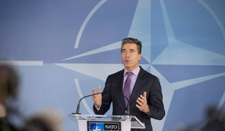 NATO Secretary General Anders Fogh Rasmussen speaks during media conference, prior to a meeting of defense ministers of the North Atlantic Council, at NATO headquarters in Brussels on Wednesday, Feb. 26, 2014. Frustrated with his Afghan counterpart, U.S. President Barack Obama is ordering the Pentagon to accelerate planning for a full U.S. troop withdrawal from Afghanistan by the end of this year. But Obama is also holding out hope that Afghanistan's next president may eventually sign a stalled security agreement that could prevent the U.S. from having to take that step. (AP Photo/Virginia Mayo)