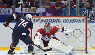 FILE - In this Feb. 15, 2014 file photo, Russia goaltender Sergei Bobrovsky defends a shot by USA forward T.J. Oshie (74) during a shootout in a men's ice hockey game at the 2014 Winter Olympics in Sochi, Russia. All of the Columbus Blue Jackets including Bobrovsky are back with the team and preparing for the NHL season's restart after a three-week respite. (AP Photo/Mark Humphrey, File)