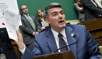 "Rep. Cory Gardner, R-Colo., holds up a letter he wrote to Health and Human Services Secretary Kathleen Sebelius asking that she consider waiving ""Obamacare"" for the 4th Congressional District of Colorado, as she testified before the House Energy and Commerce Committee about the difficulties plaguing the debut of the healthcare program, on Capitol Hill in Washington, Wednesday, Oct. 30, 2013. (AP Photo/J. Scott Applewhite)"