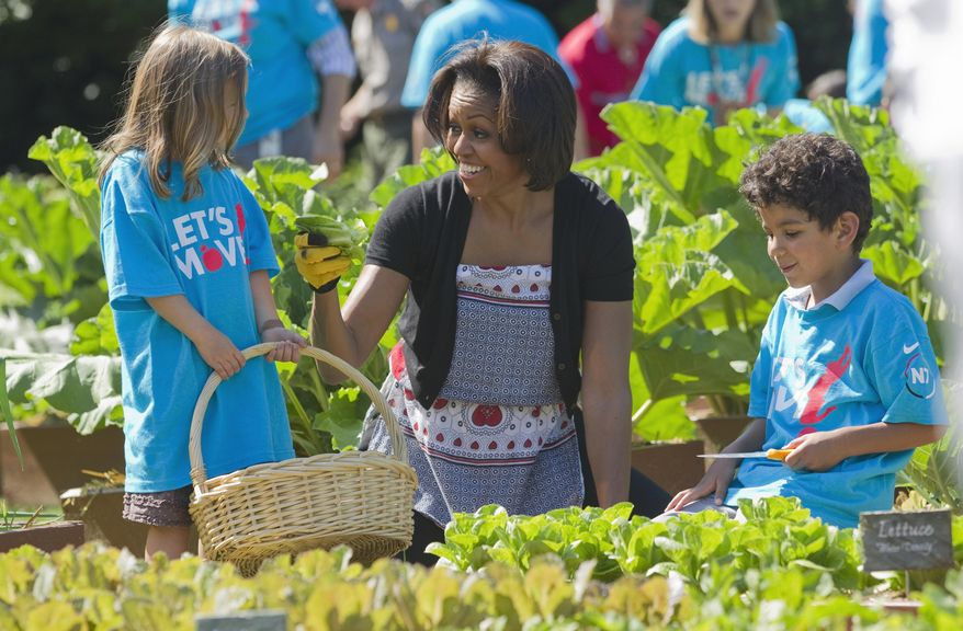 """FILE - In this June 3, 2011, file photo, first lady Michelle Obama tends the White House garden in Washington, with a group of children as part of the """"Let's Move!"""" campaign. A government report published online Tuesday, Feb. 25, 2014, in The Journal of the American Medical Association found that, overall, both adult and childhood obesity rates have been flat in the past decade however, the preschool obesity rate _ those children ages 2 to 5 _ decreased to 8 percent, from 14 percent a decade ago. That would represent a 43 percent drop. While Obama's """"Let's Move"""" campaign and other efforts over the past 10 years have raised awareness about childhood obesity, stumbling blocks remain for some working parents. (AP Photo/Evan Vucci, File)"""