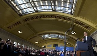 President Barack Obama speaks at Union Depot in St. Paul, Minn., Wednesday, Feb. 26, 2014, about a $300 billion transportation infrastructure plan. Obama spoke at Union Depot rail and bus station with a proposal asking Congress for $300 billion to update the nation's roads and railways, and about a competition to encourage investments to create jobs and restore infrastructure as part of the President's Year of Action. (AP Photo/Jacquelyn Martin)