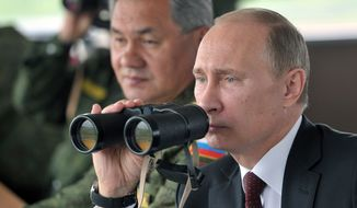 ** FILE ** In this Tuesday, July 16, 2013, file photo, Russian President Vladimir Putin, flanked by Defense Minister Sergei Shoigu, uses binocular as he watches military exercise near Yuzhno-Sakhalinsk, on Sakhalin Island, Russia. (AP Photo/RIA Novosti, Alexei Nikolsky, Presidential Press Service, Pool)