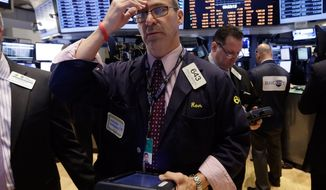 Trader Ronald Madarasz works on the floor of the New York Stock Exchange, Wednesday, Feb. 26, 2014.The stock market is little changed as investors pick over more earnings reports from retailers and other U.S. companies. (AP Photo/Richard Drew)