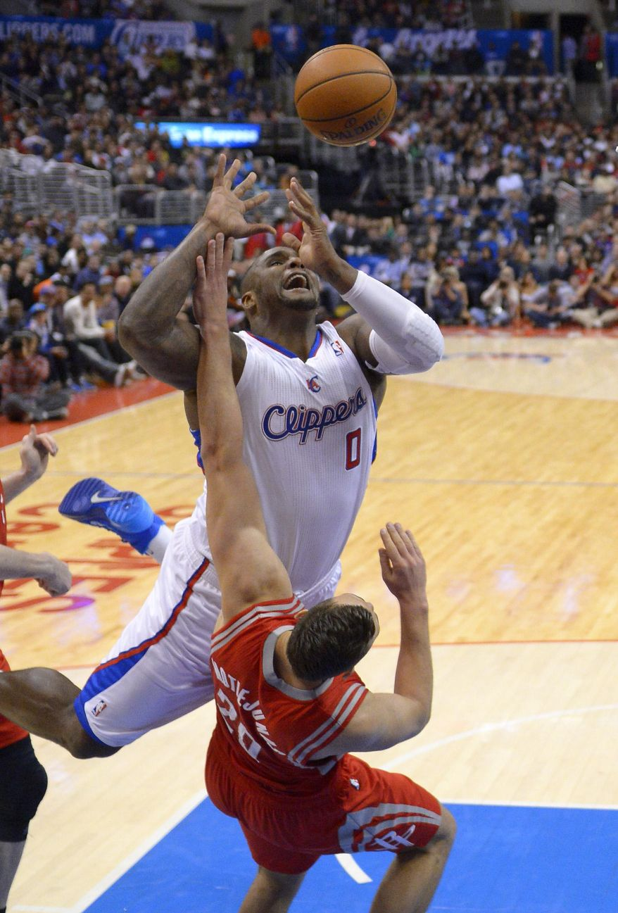 Los Angeles Clippers forward Glen Davis, top, puts up a shot as Houston Rockets forward Donatas Motiejunas, of Poland, defends during the second half of an NBA basketball game, Wednesday, Feb. 26, 2014, in Los Angeles. (AP Photo/Mark J. Terrill)