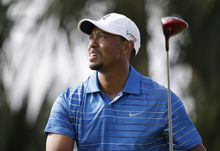 Golfer Tiger Woods watches his tee shot on the 18th hole during the first round of the Honda Classic golf tournament, Thursday, Feb. 27, 2014 in Palm Beach Gardens, Fla. (AP Photo/Wilfredo Lee)