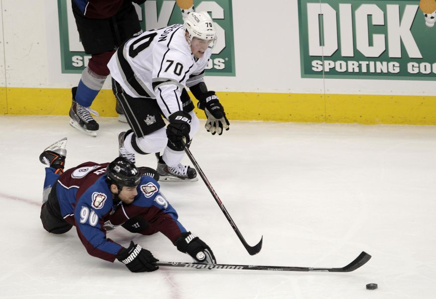 Colorado Avalanche center Ryan O'Reilly (90) dives for the puck against Los Angeles Kings left wing Tanner Pearson (70) in the first period of an NHL game, Wednesday, Feb. 26, 2014 in Denver. (AP Photo/Joe Mahoney)