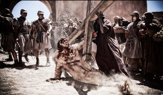 "Diogo Morgado is painful to watch but hard to turn away from during the Crucifixion of Jesus in ""Son of God,"" one of three religious-themed movies at the box office this year. (20th Century Fox via Associated Press)"
