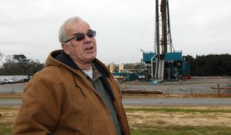 In this Dec. 23, 2013 photograph, Amite County Supervisor Max Lawson describes the convoy of about 200 trucks carting in a drilling rig and other gear on what was pasture land at his Gillsburg, Miss., farm. After a little more than a two-year wait, Encana Corp., contractors were finally drilling. Oil companies plan a big increase in drilling activity in 2014 in southwest Mississippi. They're trying to extract oil from a formation called the Tuscaloosa Marine Shale, which one study says could hold 7 billion barrels. (AP Photo/Rogelio V. Solis)