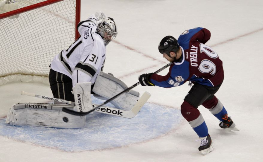 Colorado Avalanche center Ryan O'Reilly (90) scores against Los Angeles Kings goalie Martin Jones (31) in the first period of an NHL game, Wednesday, Feb. 26, 2014 in Denver. (AP Photo/Joe Mahoney)