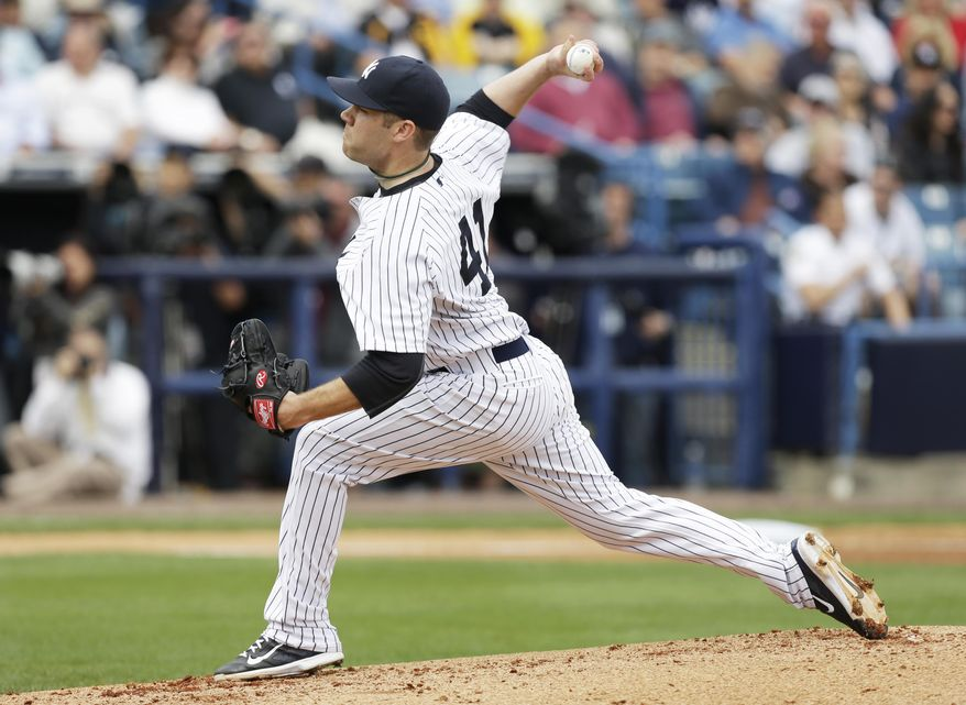 New York Yankees starting pitcher David Phelps throws a pitch during the first inning of an exhibition baseball game against the Pittsburgh Pirates Thursday, Feb. 27, 2014, in Tampa, Fla. (AP Photo/Charlie Neibergall)