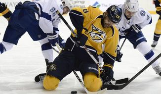 Tampa Bay Lightning right wing Nikita Kucherov (86), of Russia, Nashville Predators forward Paul Gaustad (28) and Lightning center Tyler Johnson (9) battle for the puck in the first period of an NHL hockey game, Thursday, Feb. 27, 2014, in Nashville, Tenn. (AP Photo/Mark Zaleski)