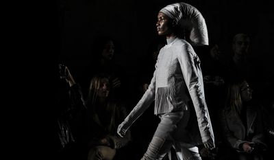 A model wears a creation for Rick Owens's ready-to-wear fall/winter 2014-2015 fashion collection presented in Paris, Thursday, Feb.27, 2014. (AP Photo/Zacharie Scheurer)