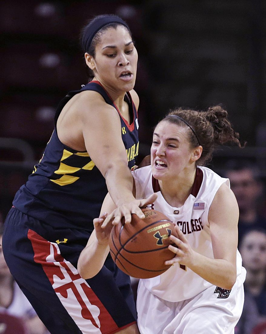 Maryland center Brionna Jones (42) reaches over and knocks the ball from the hands of Boston College guard Nicole Boudreau, right, during the first half of an NCAA college basketball game, Thursday, Feb. 27, 2014, in Boston. (AP Photo/Charles Krupa)