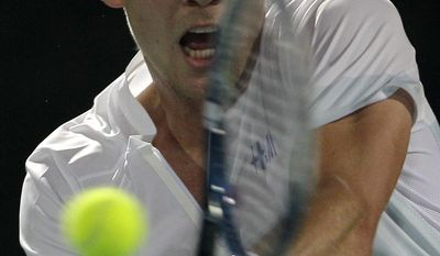 Tomas Berdych of the Czech Republic returns the ball to Jo Wilfried Tsonga of France during a quarter final match of the Dubai Duty Free Tennis Championships in Dubai, United Arab Emirates, Thursday, Feb. 27, 2014. (AP Photo/Kamran Jebreili)