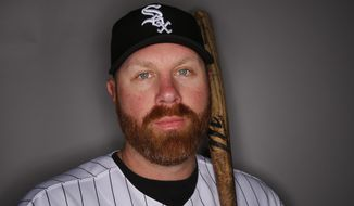 "FILE - In this Saturday, Feb. 22, 2014 file photo, Chicago White Sox Adam Dunn poses for his photograph during baseball spring training photo day in Glendale, Ariz. Dunn on Thursday, Feb 27, 2014 said he'll be attending this year's Academy Awards with the contingent from the Matthew McConaughey film ""Dallas Buyers Club."" (AP Photo/Paul Sancya, file)"