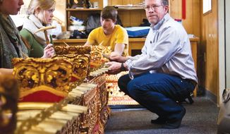 In this photo taken on Friday, Feb. 21, 2014, University of Wyoming music professor Rod Garnett instructs students in Gamelan, or traditional Balinese music, in one of the University of Wyoming's Fraternity Mall trailers in Laramie, Wyo. (AP Photo/Laramie Boomerang, Peter Baumann)