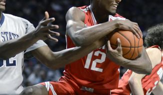 Ohio State's Sam Thompson takes possession of a rebound during the first half of an NCAA college basketball game against Penn State, Thursday, Feb. 27, 2014, in State College, Pa. (AP Photo/Ralph Wilson)