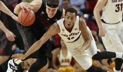 Arizona State guard Calaen Robinson tries to steal the ball from Stanford forward Dwight Powell during the first half at Wells Fargo Arena in Tempe, Ariz. , Wednesday, Feb. 26, 2014.  (AP Photo/The Arizona Republic, Michael Chow)