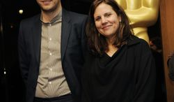 """Zachary Heinzerling, left, writer/director of the Oscar-nominated documentary film """"Cutie and the Boxer,"""" poses with the film's producer Lydia Dean Pilcher at a reception featuring the Oscar nominees in the Documentary Feature and Documentary Short Subject categories on Wednesday, Feb. 26, 2014, in Beverly Hills, Calif. The Oscars will be held on Sunday at the Dolby Theatre in Los Angeles. (Photo by Chris Pizzello/Invision/AP)"""