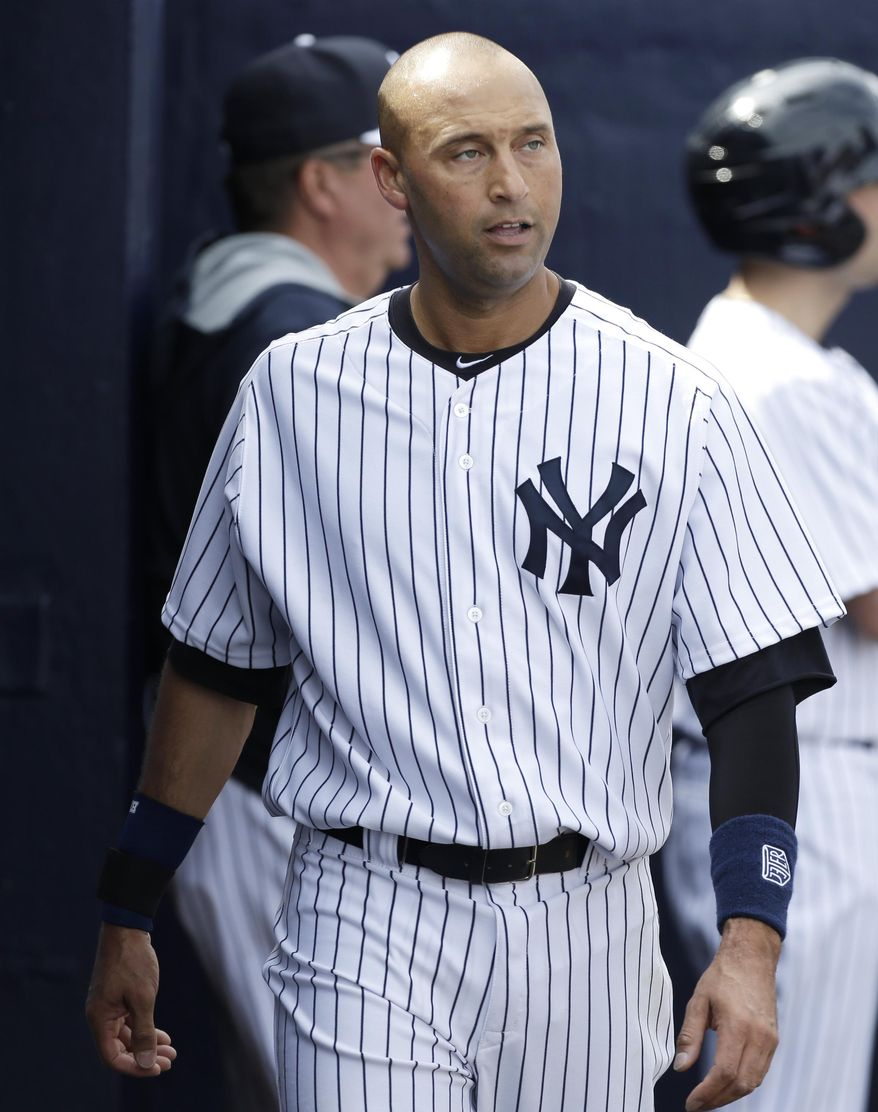 New York Yankees shortstop Derek Jeter walks in the dugout during the fourth inning of an exhibition baseball game against the Pittsburgh Pirates Thursday, Feb. 27, 2014, in Tampa, Fla. (AP Photo/Charlie Neibergall)